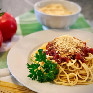 easy vegan parmesan cheese on spaghetti