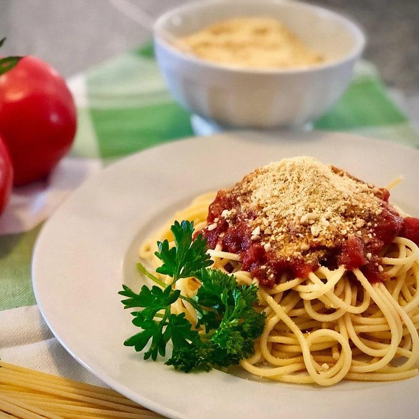 easy vegan parmesan cheese on spaghetti