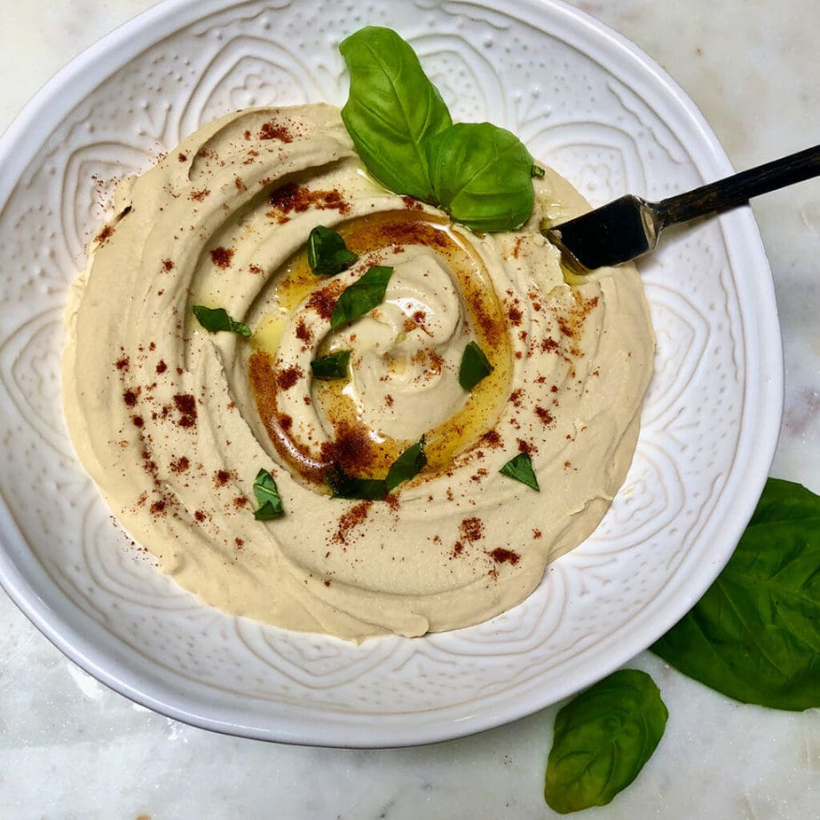 heavenly homemade hummus in bowl with olive oil and paprika