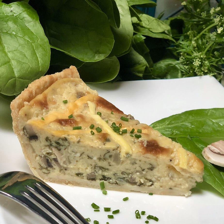 vegan spinach mushroom quiche slice