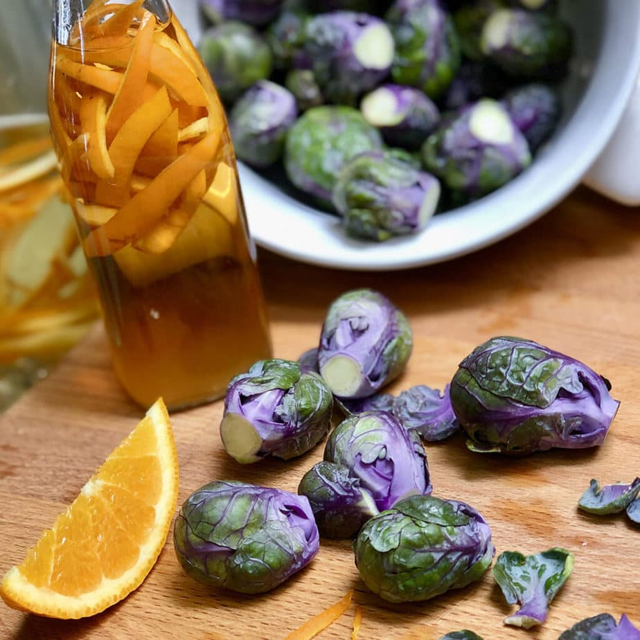 purple brussels sprouts spilling from a colander