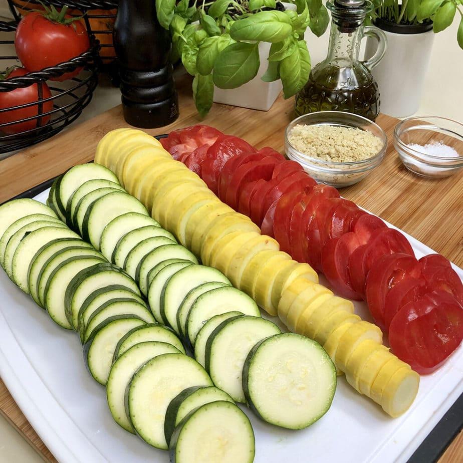 fresh cut zucchini, yellow squash and tomatoes