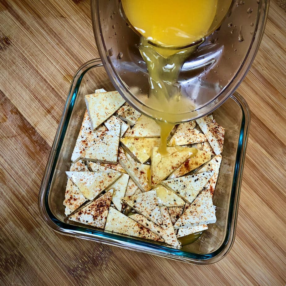pouring orange juice on tofu