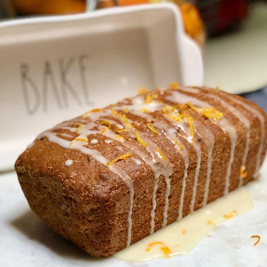 vegan orange cranberry bread with citrus icing drizzle