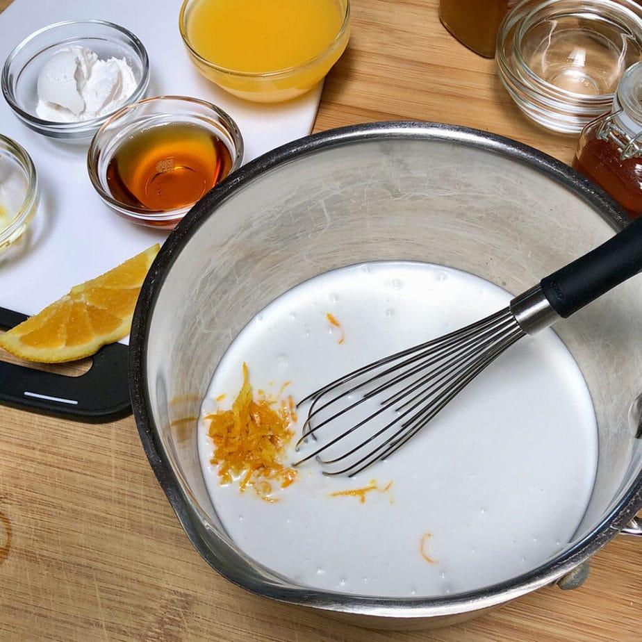 bowl with orange zest and coconut cream