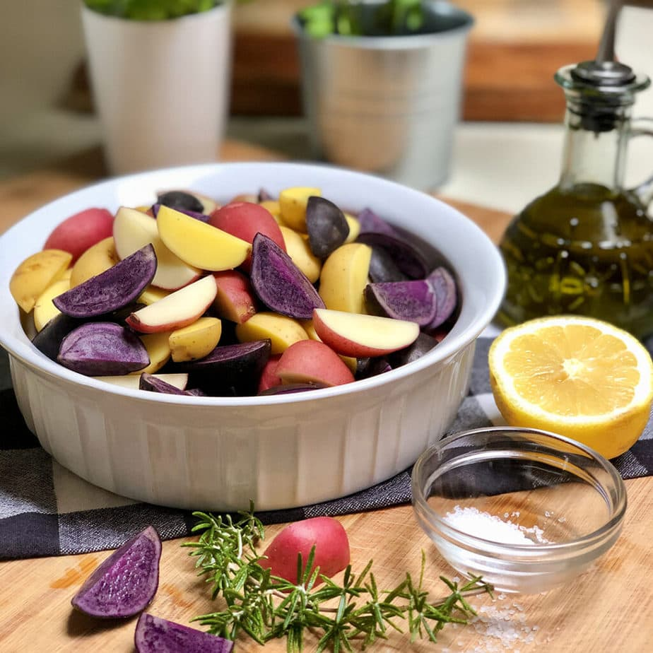 red, yukon gold and purple potato wedges in a bowl