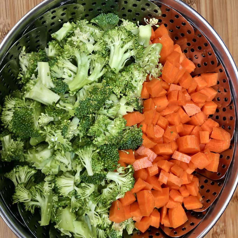 broccoli and carrots in steamer basket