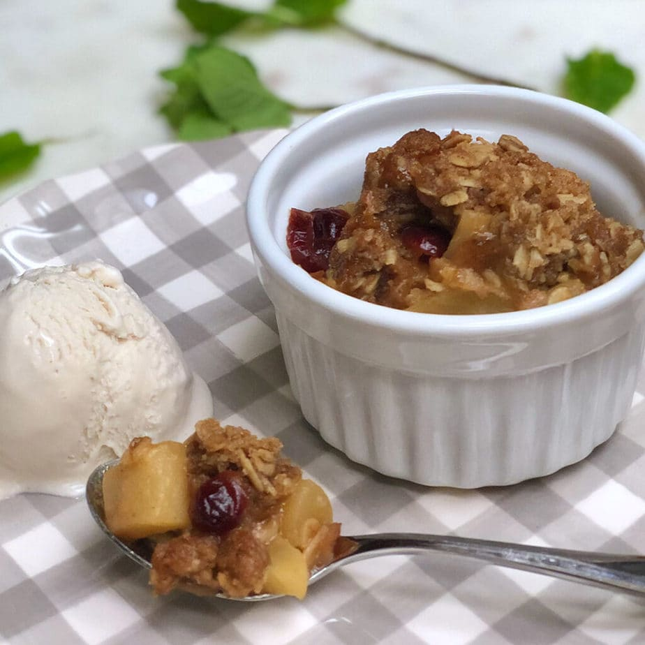 vegan apple crisp plated with began vanilla ice cream